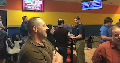 CP Professional Services employees bowl together during a team-building outing. Photo provided.